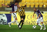 Phoenix' Leo bertos is fouled by Wayne Srhoj as Adriano Pellegrino takes the ball during the A-League football match between Wellington Phoenix and Perth Glory at Westpac Stadium, Wellington, New Zealand on Sunday, 16 August 2009. Photo: Dave Lintott / lintottphoto.co.nz