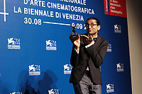 VENICE, ITALY - SEPTEMBER 09: Alireza Khatam poses with the Orizzonti Award for Best Screenplay Award for 'Los Versos Del Olvido' (Oblivion Verses) at the Award Winners photocall during the 74th Venice Film Festival at Sala Casino on September 9, 2017 in Venice, Italy. ()<br /> CAP/MPI/AF<br /> &copy;AF/MPI/Capital Pictures
