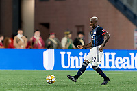 FOXBOROUGH, MA - SEPTEMBER 21: Luis Caicedo #27 of New England Revolution passes the ball during a game between Real Salt Lake and New England Revolution at Gillette Stadium on September 21, 2019 in Foxborough, Massachusetts.