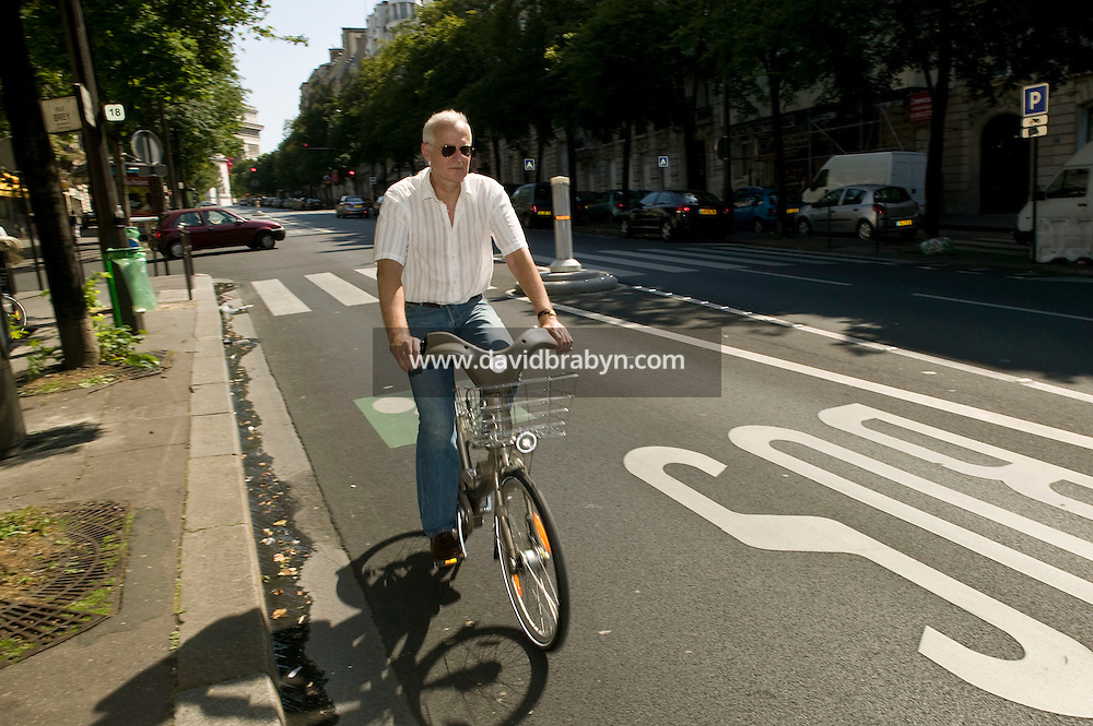 The Times newspaper Paris correspondent Charles Bremner rides a Velib' bicycle in Paris, France, 15th July 2007. The city of Paris launched this low-cost self-service bicycle system today with a fleet of 10,000 bicycles.