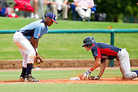 Third baseman Addison Russell #21 of Dixie waits for the throw as Spencer Edwards #3 of AABC slides into third base at the 2011 Tournament of Stars at the USA Baseball National Training Center on June 25, 2011 in Cary, North Carolina.  The AABC defeated Dixie 4-2.  (Brian Westerholt/Four Seam Images)