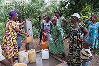 Village women using the neu water point financed by a donner with the  villagers partecipation