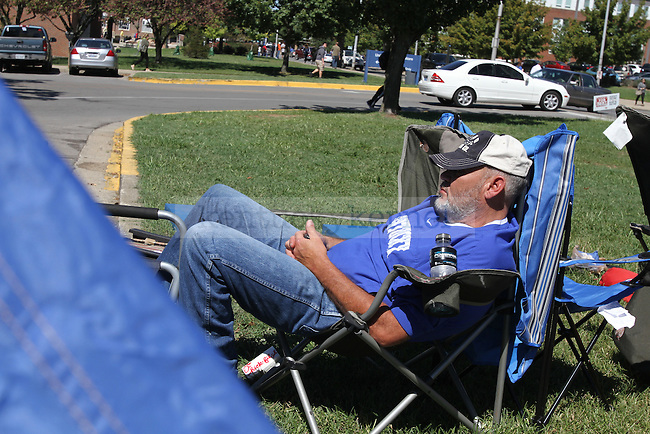 A wildcat fan takes a quick nap while camping outside Memorial Coliseum for Big Blue Madness tickets at University of Kentucky on Wednesday, Sept. 19, 2012. Photo by Kirsten Holliday | Staff