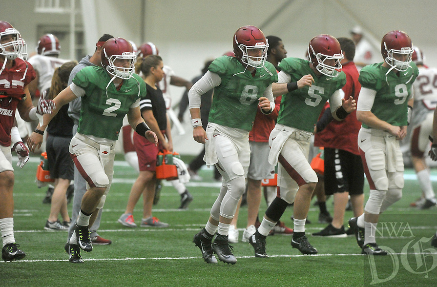NWA Democrat-Gazette/MICHAEL WOODS &bull; @NWAMICHAELW<br /> University of Arkansas quarterbacks Rafe Peavey (2) Austin Allen (8) Ty Storey (5) and Ricky Town (9) run drills during practice Tuesday, April 5, 2016 in Fayetteville.
