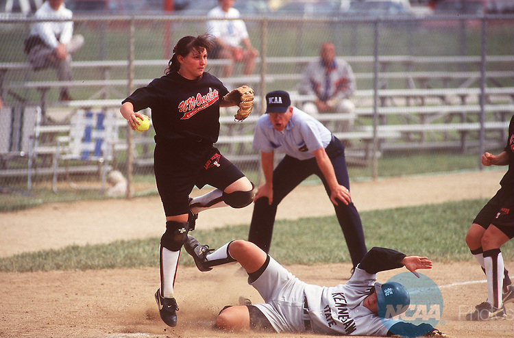 Caption: 20 MAY 1996: University of Nebraskaâ??Omaha infielder Mindy Hahne (12) tags out a Kennesaw State opponent during the Division 2 Women's Softball Championship held at Joe Cannon Field, Emporia State University in Emporia, Kansas. Kennesaw State College defeated the University of Nebraska 6-4. Jeff Jacobsen/NCAA Photos.