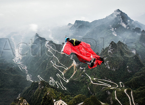 13.10.2016. Zhangjiajie, Hunan Province, China.  Gabriel Lott of Brazil glides during the qualification of World Wingsuit League (WWL) China Grand Prix 2016 in Zhangjiajie,   Hunan Province, Oct. 13, 2016. Only ten of the total sixteen fliers took part in the competition due to the weather on Thursday.