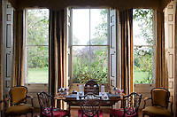 A bay of sash windows in the drawing room makes an ideal spot for a writing desk overlooking the garden
