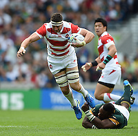 Luke Thompson of Japan escapes the clutches of Tendai Mtawarira of South Africa. Rugby World Cup Pool B match between South Africa and Japan on September 19, 2015 at the Brighton Community Stadium in Brighton, England. Photo by: Patrick Khachfe / Onside Images
