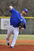 Pitcher Ridge Chapman (18) of the Spartanburg Methodist College Pioneers delivers a pitch in a junior college game against Surry Community College on January 31, 2016, at Mooneyham Field in Spartanburg, South Carolina. (Tom Priddy/Four Seam Images)