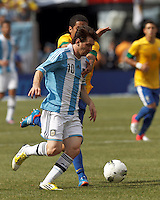 Argentina forward  Lionel Messi (10) drives for the net. In an international friendly (Clash of Titans), Argentina defeated Brazil, 4-3, at MetLife Stadium on June 9, 2012.