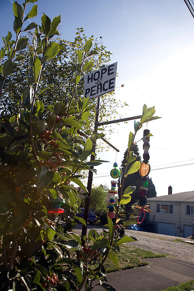 "08 October 2009 - Portland, Oregon - A tree decorated with mobiles and a ""Hope and Peace"" sign in the northeast section of Portland.  Photo Credit: Elizabeth A. Miller/Sipa Press"