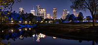 Another capture of Houston cityscape pano along the Buffalo Bayou near the Police Memorial after dark in downtown part of city. We like the Houston skyline from this location which run along the Buffalo Bayou and gives off a nice reflection from the city and the trail lights giving off a faint blue glow among the trees and in the bayou with the fantastic cityscape in the background. Houston has some of the tallest buildings in Texas and the southwestern US so you can be miles from downtown and still see them.