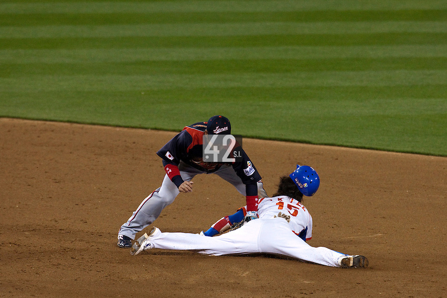 23 March 2009: #15 Yong-Kyu Lee of Korea collides with #6 Hiroyuki Nakajim of Japan as he slides head first trying to steal second base in the sixth inning during the 2009 World Baseball Classic final game at Dodger Stadium in Los Angeles, California, USA. Japan defeated Korea 5-3