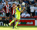 Jake Wright of Sheffield Utd  tussles with Chris Martin of Derby County during the Championship match at Bramall Lane, Sheffield. Picture date 26th August 2017. Picture credit should read: Simon Bellis/Sportimage