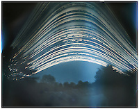 A six month pinhole photo of the sun moving across the sky. The exposure started December 21, 2011 and ended on June 21, 2012.  The suns relative motion is recorded on one image.  The lines are the sun crossing the sky each day - while the breaks in the lines are where the clouds blocked the sun.  Photographed in Rochester, New York, USA.