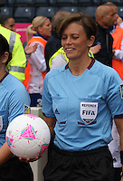 Women's Olympic Football match France v Sweden on 3.8.12...Referee Kari Seitz of the United States of America, leads out the teams before the Women's Olympic Football match between France v Sweden at Hampden Park, Glasgow...............