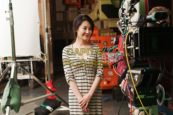Looper (2012)<br /> Behind the scenes photo of Xu Qing<br /> *Filmstill - Editorial Use Only*<br /> CAP/KFS<br /> Image supplied by Capital Pictures