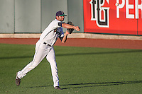 Cedar Rapids Kernels pitcher Randy LeBlanc (15) warms up in the outfield prior to game five of the Midwest League Championship Series against the West Michigan Whitecaps on September 21st, 2015 at Perfect Game Field at Veterans Memorial Stadium in Cedar Rapids, Iowa.  West Michigan defeated Cedar Rapids 3-2 to win the Midwest League Championship. (Brad Krause/Four Seam Images)