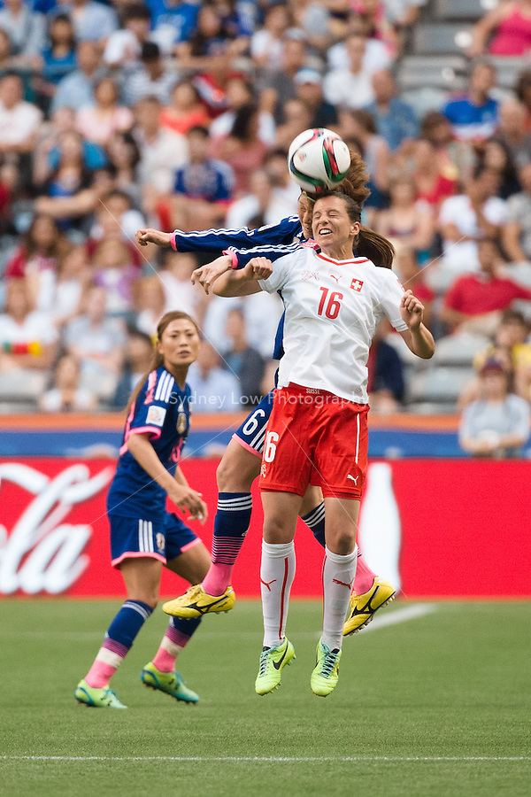 June 8, 2015: Fabienne HUMM of Switzerland heads the ball during a Group C match at the FIFA Women's World Cup Canada 2015 between Japan and Switzerland at BC Place Stadium on 8 June 2015 in Vancouver, Canada. Sydney Low/AsteriskImages