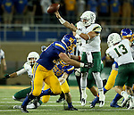 BROOKINGS, SD - SEPTEMBER 17: Ryan Earith #90 from South Dakota State University  prepares to tackle Dano Graves #7 from Cal Poly as he throws over him in the second half of their game Saturday night at the Dana J. Dykhouse Stadium in Brookings. (Photo by Dave Eggen/Inertia)