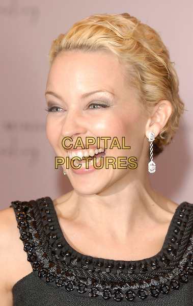 """KYLIE MINOGUE.At the launch of her perfume """"Darling"""" at the Harrods Perfume Department, London, UK..February 9th, 2007.headshot portrait earrings smiling.CAP/FIN.©Steve Finn/Capital Pictures"""