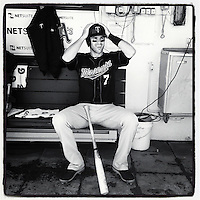 OAKLAND, CA - AUGUST 22: Instagram of Joe Mauer of the Minnesota Twins getting ready in the dugout before the game against the Oakland Athletics at O.co Coliseum on Wednesday, August 22, 2012 in Oakland, California. Photo by Brad Mangin