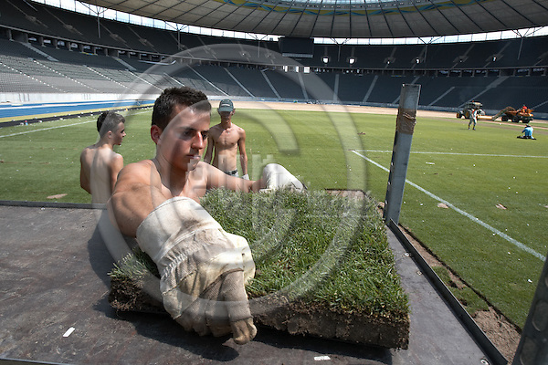 "BERLIN - GERMANY 11. JULY 2006 -- A german  post order company has bought the finale-grass in Berlins Olypiastadion and will sell between 40.000 and 60.000 pieces via the internet. The penalty piece has allready been sold for 4000,89 Euro - Polish holliday workers did Tuesday cut up and carry away the hole grass field -- PHOTO: CHRISTIAN T. JOERGENSEN / EUP & IMAGES..This image is delivered according to terms set out in ""Terms - Prices & Terms"". (Please see www.eup-images.com for more details)"