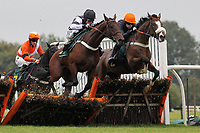 Race winner Makari ridden by Andrew Tinkler jumps alongside House Party ridden by Denis O'Regan (R) in the Huge Prize Money At Fakenham 26th October Novices Hurdle