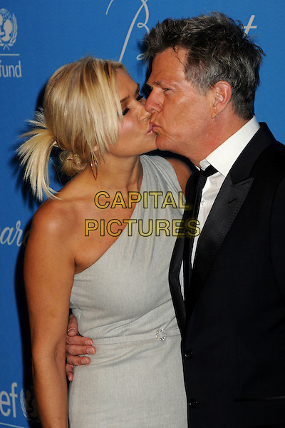YOLANDA HADID & DAVID FOSTER.UNICEF Ball 2009 Honoring Jerry Weintraub held at the Beverly Wilshire Hotel, Beverly Hills, California, USA..December 10th, 2009.half length suit black grey gray one shoulder profile kiss kissing married husband wife.CAP/ADM/BP.©Byron Purvis/AdMedia/Capital Pictures.