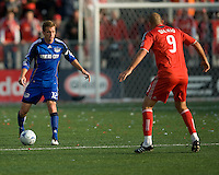 26 April 2009: Kansas City Wizards defender Jimmy Conrad #12 and Toronto FC forward Danny Dichio #9 in action during an MLS game between Kansas City Wizards and Toronto FC.Toronto FC won 1-0. .