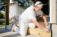 NWA Democrat-Gazette/DAVID GOTTSCHALK  James McAnear, of McAnear Painting of Bentonville, prepares the deck Tuesday, September 29, 2015 of a home for painting in Bentonville. McAnear was painting the trim on both the interior and exterior of the home.