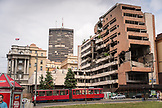 SERBIA, Belgrade, The city tram passes the former Yugoslavian Ministry of Defense building bombed by NATO in the Balkan War of the 1990s, Eastern Europe