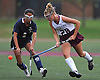Emily Clarke #28 of Garden City, right, and Emma Wong #1 of Baldwin battle for possession during a Nassau County Conference I varsity field hockey match at Garden City High School on Friday, Sept. 30, 2016. Garden City won by a score of 7-0.