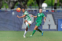 8 November 2015:  North Texas Defender Carissa Sanders (19) passes the ball as Marshall Forward Mack Moore (10) looks on in the second half as the University of North Texas Mean Green defeated the Marshall University Thundering Herd, 1-0, in the Conference USA championship game at University Park Stadium in Miami, Florida.