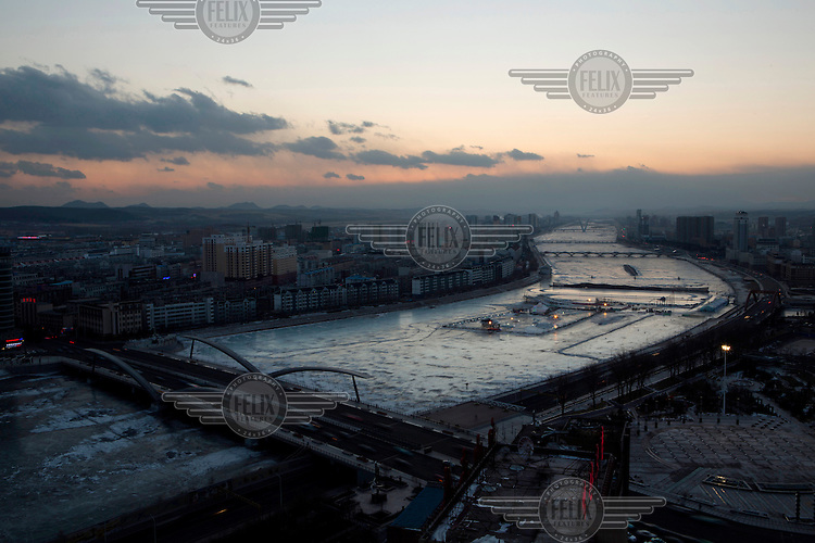 The frozen Tumen River where it runs through Yanji a town on the border with North Korea. Yanji is known for its large ethnic Korean Chinese population. It also supports clandestine networks for North Korean defectors as well as legal and illegal cross border trading. /Felix Features