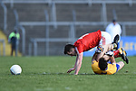 Alan Sweeney of Clare in action against Andy Mc Donnell of Louth during their national League game in Cusack Park. Photograph by John Kelly.
