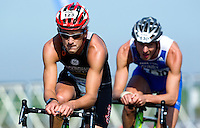 25 MAR 2012 - LOUGHBOROUGH, GBR - Mark Buckingham (Holmfirth Harriers) (left) leads Matt Gunby (PACTRAC) on the bike during the men's 2012 British Elite Duathlon Championships at Prestwold Hall Airfield in Prestwold near Loughborough, Great Britain  (PHOTO (C) 2012 NIGEL FARROW)