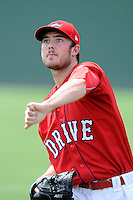 Starting pitcher Daniel McGrath (17) of the Greenville Drive warms up before a game against the Augusta GreenJackets on Sunday, July 13, 2014, at Fluor Field at the West End in Greenville, South Carolina. Greenville won, 8-5. (Tom Priddy/Four Seam Images)