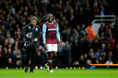 14.09.2015. London, England. Football - Barclays Premier League. West Ham versus Newcastle United.  West Ham United's Angelo Ogbonna forced to come off in the first half with an injury