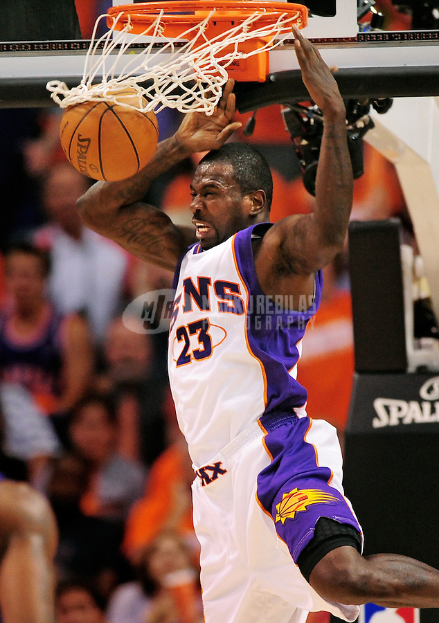 May 3, 2010; Phoenix, AZ, USA; Phoenix Suns guard (23) Jason Richardson dunks the ball against the San Antonio Spurs in game one in the western conference semifinals of the 2010 NBA playoffs at the US Airways Center. The Suns defeated the Spurs 111-102. Mandatory Credit: Mark J. Rebilas-