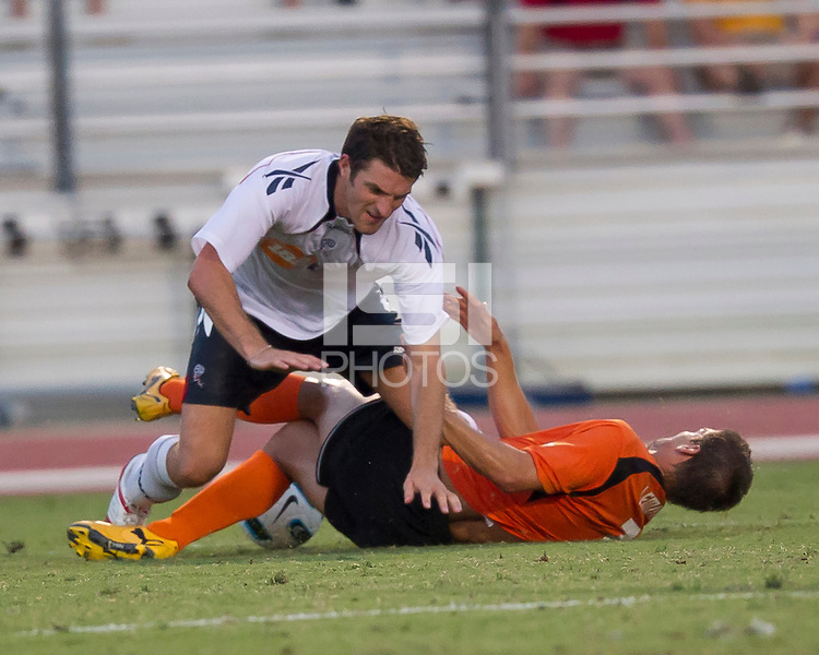 Samuel Ricketts (BW) attempts to evade a Chris Lemmons (CE) slide tackle.  The Charlotte Eagles currently in 3rd place in the USL second division played a friendly against the Bolton Wanderers from the English Premier League losing 3-0.
