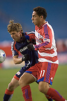 New England Revolution midfielder Wells Thompson (7) chases down a pass as FC Dallas midfielder Andre Rocha (11) defends. The New England Revolution defeated FC Dallas, 2-1, at Gillette Stadium on April 4, 2009. Photo by Andrew Katsampes /isiphotos.com