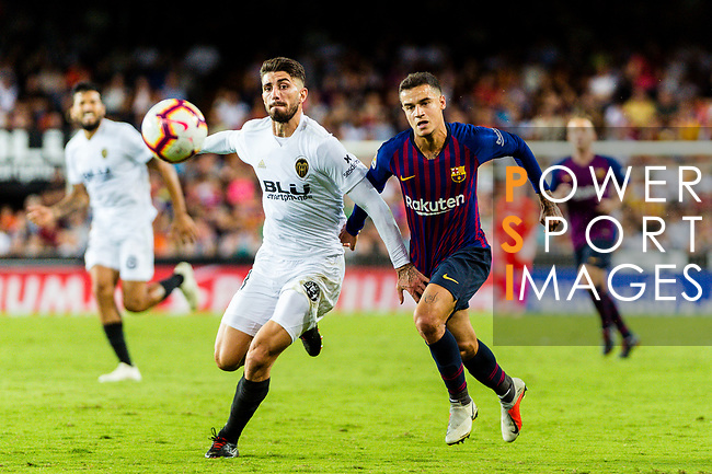 Philippe Coutinho of FC Barcelona (R) battles for the ball with Cristiano Piccini of Valencia CF (L) during their La Liga 2018-19 match between Valencia CF and FC Barcelona at Estadio de Mestalla on October 07 2018 in Valencia, Spain. Photo by Maria Jose Segovia Carmona / Power Sport Images
