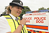 Parks Constabulary Policewoman by Police Dog van on radio in Finsbury Park Haringey London UK