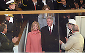 United States President Bill Clinton, right, accompanied by first lady Hillary Rodham Clinton, left, and Chelsea Clinton, center back and partially obscured, arrive in the White House reviewing stand on Pennsylvania Avenue to watch the Inaugural Parade on January 20, 1997.<br /> Credit: Arnie Sachs / CNP