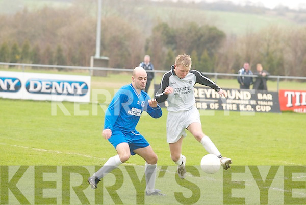 Lisselton Rovers centre forward Ger Lovett tries to force his way past Gareth Ryan of Ballynanty Rovers in their Munster Junior Cup quarter final match at Mounthawk on Sunday..