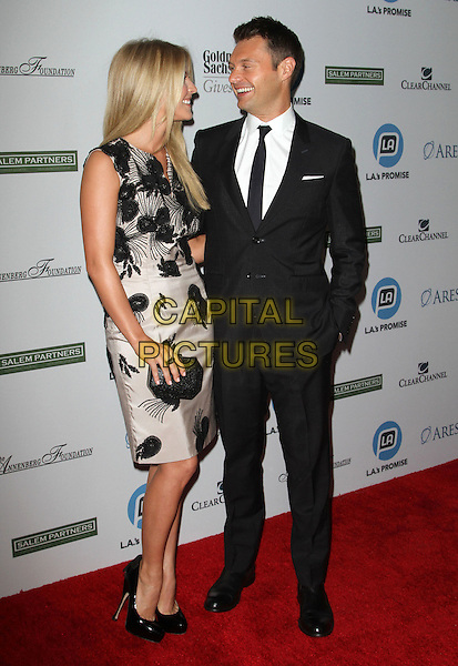 ulianne Hough and Ryan Seacrest.LA's Promise Honors Ryan Seacrest At 2011 Gala Held at A the Kodak Theatre, Hollywood, California, USA..27 September 2011.full length black white suit dress floral print sleeveless side profile clutch bag smiling .CAP/ADM/KB.©Kevan Brooks/AdMedia/Capital Pictures.