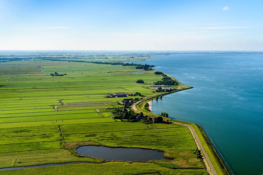Nederland, Noord-Holland, Gemeente Edam-Volendam, 13-06-2017; Polder Zeevang met Zeevangse Zeedijk, IJsselmeerdijk ten noorden van Edam.<br /> De dijk staat op de nominatie om verstrekt te worden, bewoners en actievoerders vrezen aantasting van de monumentale dijk en verlies culturele waarden.<br /> Zeevangse Zeedijk (seawall) north of Edam.<br /> The dike is nominated to be reinforced, residents and activists fear losing the monumental quality of the dike and losing other cultural values.<br /> <br /> luchtfoto (toeslag op standaard tarieven);<br /> aerial photo (additional fee required);<br /> copyright foto/photo Siebe Swart