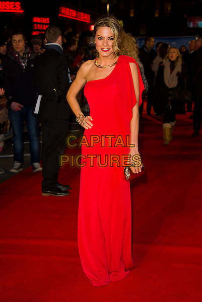 Charlotte Jackson.Attending the UK film Premiere of 'Flight' at the Empire Cinema, Leicester Square, London, England, UK, .17th January 2013..full length one shoulder red long maxi dress hand on hip clutch bag gold .CAP/CJ.©Chris Joseph/Capital Pictures.
