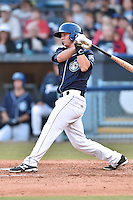 Asheville Tourists catcher Ashley Graeter #6 swings at a pitch during a game against the Lakewood BlueClaws at McCormick Field on May 3, 2014 in Asheville, North Carolina. The BlueClaws defeated the Tourists 7-4. (Tony Farlow/Four Seam Images)